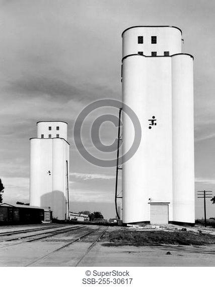 Grain elevators in a field, Fort Dodge, Iowa, USA