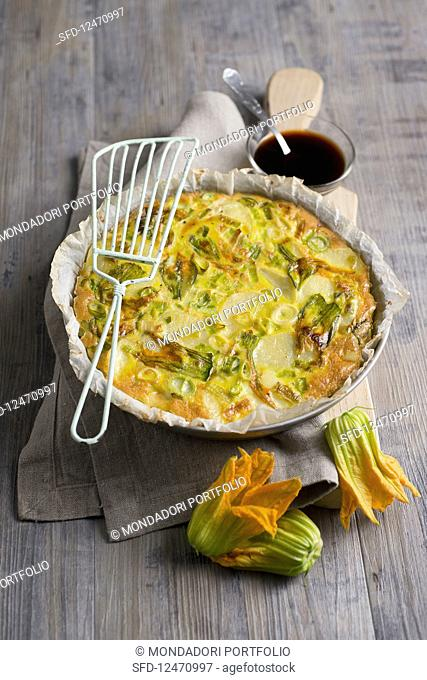 Tortilla with spring onions and pumpkin flowers