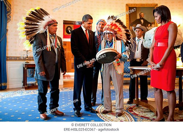 Presidential Medal of Freedom recipient Joseph Medicine Crow historian author and WW II veteran shows a drum to President Obama and Michelle Obama