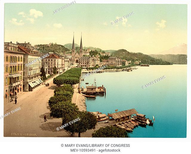 The quay, from the Swan Hotel, Lucerne, Switzerland. Date between ca. 1890 and ca. 1900