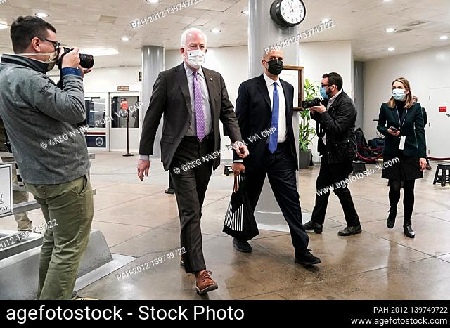 Sens. John Cornyn (R-Texas) and Cory Booker (D-N.J.) arrive at the Capitol on Wednesday, February 10, 2021 for the second day of the impeachment trial of former...