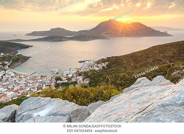 Fourni town and Thymaina island as seen from acropolis at sunset, Greece.