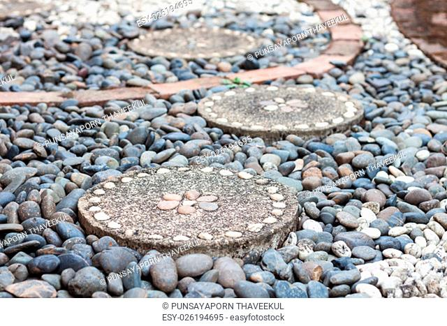 Garden stone path with pebble stone, stock photo
