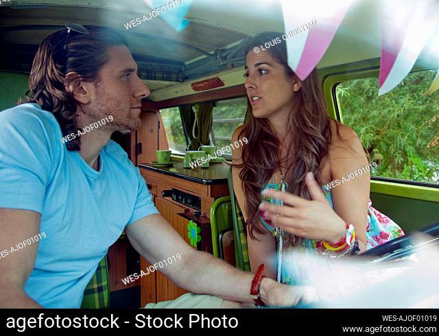 Woman with boyfriend talking in camper van
