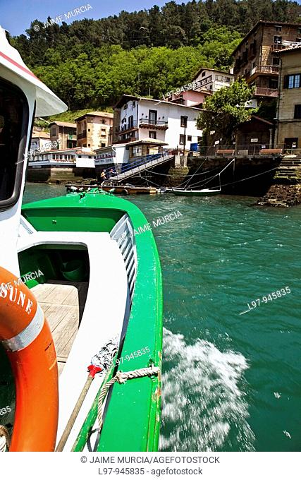 Water taxi crossing the harbor in the village of Pasaia near San Sebastian, Spain