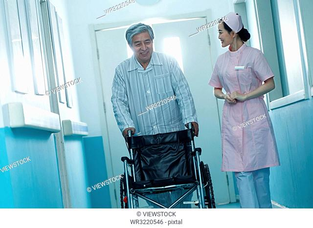 Nurses and older men in the hospital corridor