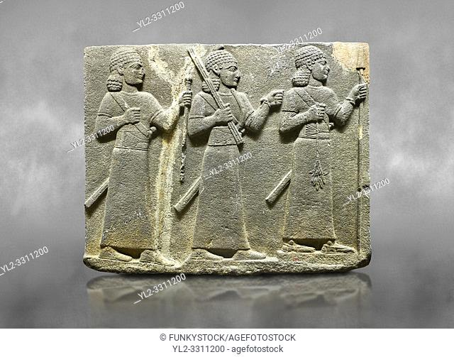 Hittite relief sculpted orthostat stone panel of Royal Buttress Basalt, Karkamıs, (Kargamıs), Carchemish (Karkemish), 900-700 B. C. Warriors