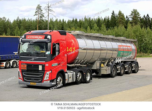 Orivesi, Finland - August 27, 2018: Red Volvo FH semi tank trailer Anneberg Transport on truck stop. ADR 90-3082 signifies pyraclostrobin. a fungicide