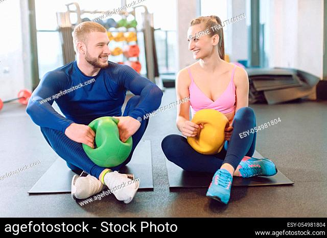Man and woman doing stomach or abdominal exercises together in core training session