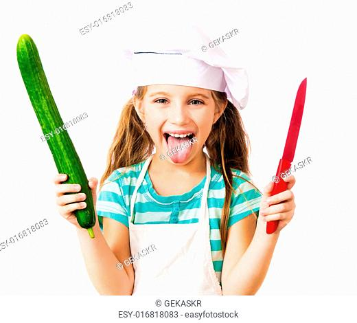 little girl in chef hat with cucumber and knife