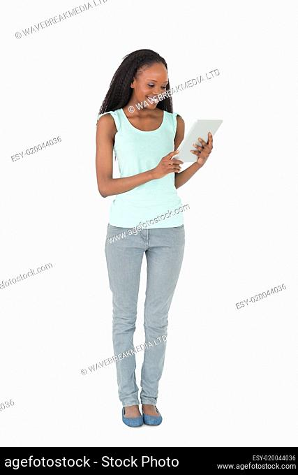 Woman using tablet on white background