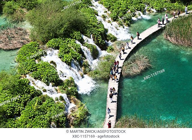 The Plitvice Lakes in the National Park Plitvicka Jezera in Croatia  Visitors on the plank paths of the national Park  The Plitvice Lakes are a string of lakes...
