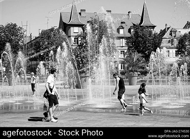 Children playing water fountain, RAPP square, Colmar, Haut Rhin, Grand Est, France, Europe