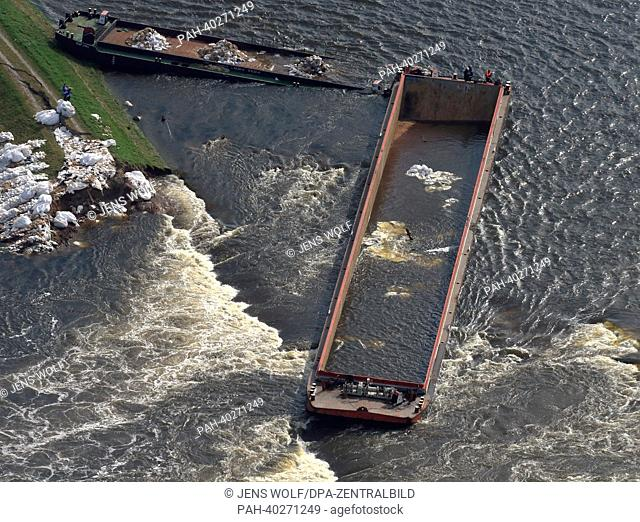 View of two cargo barges, which had been sunk on 15 June 2013 in order to reduce a breach in a levee at the Elbe, near Fischbeck, Germany, 16 June 2013
