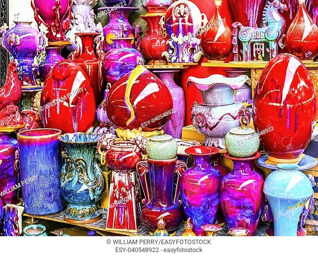 Chinese Red Multicolored Ceramic Pots Panjuan Flea Market Beijing China. Panjuan Flea Curio market has many fakes, replicas and copies of older Chinese products