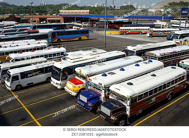 """BAlbrok bus station terminal. Panama. Here comes the Diablo Rojo, the Red Devil bus blasting its air horn and fishtailing around a fellow """"demon† just in time..."""