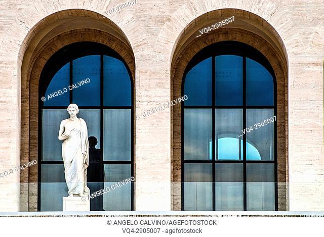 Statue in front of Palazzo della Civiltà Italiana, Colosseo Quadrato, EUR, Expo, Rome, Italy, Esposizione Universale