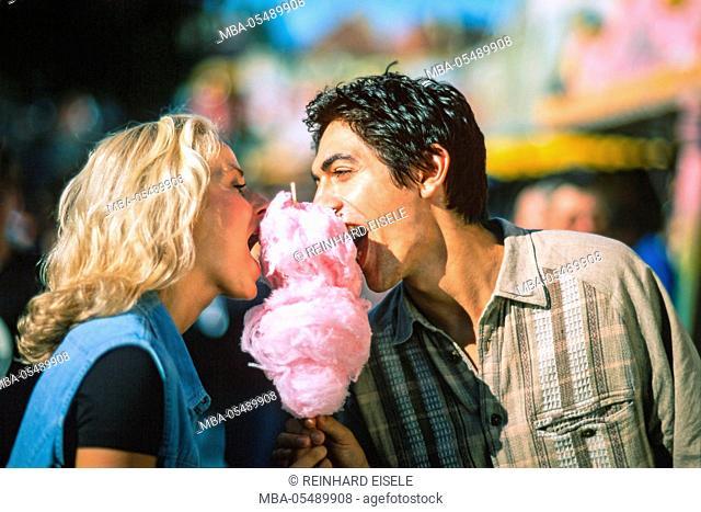Couple on fairground close candy floss