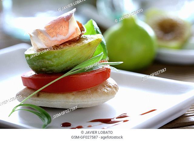 Pita bread tapa snack with tomato, fig and Iberian ham