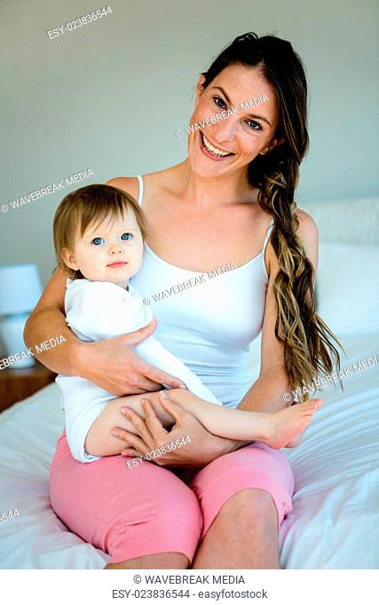 smiling woman holding a cutee baby