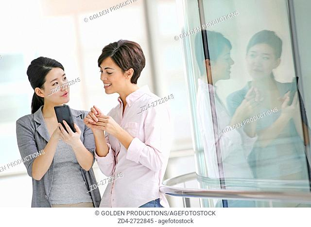 Two Businesswomen using smartphone