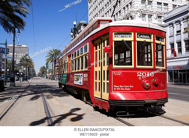 Red trolley car on the track on Canal Street in downtown New Orleans, Louisiana