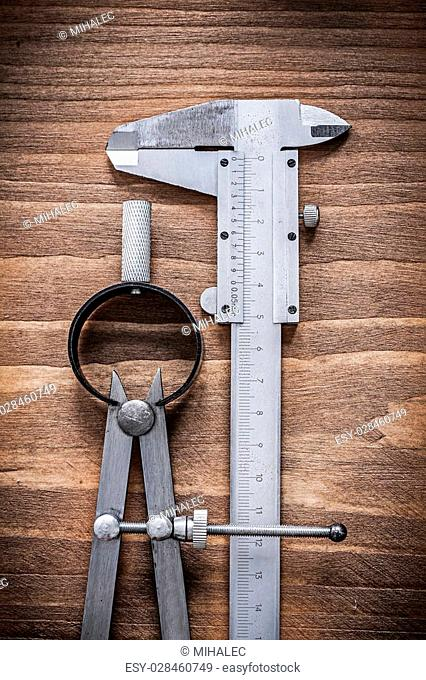Vernier scale divider on wooden board construction concept