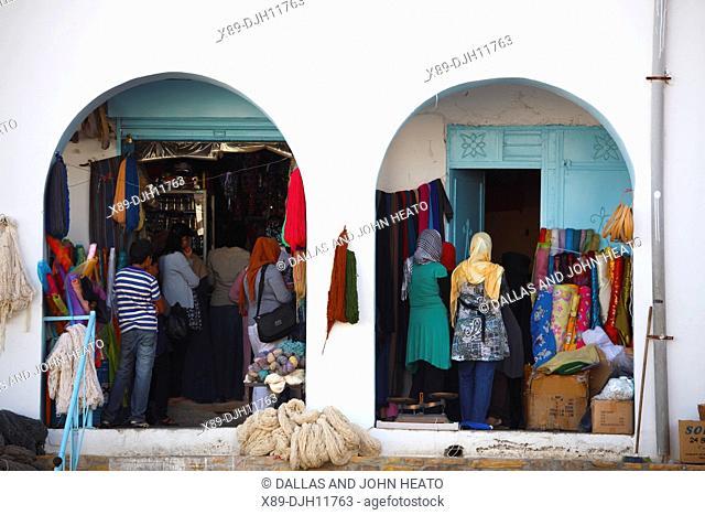 Africa, Tunisia, Tataouine, Local Shoppers at Market