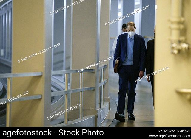 Senator Ron Wyden, a Democrat from Oregon, wears a protective mask while walking through the Senate Subway at the U.S. Capitol in Washington, D.C., U