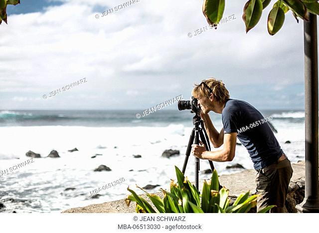 Man while taking a photo in Valle Gran Rey