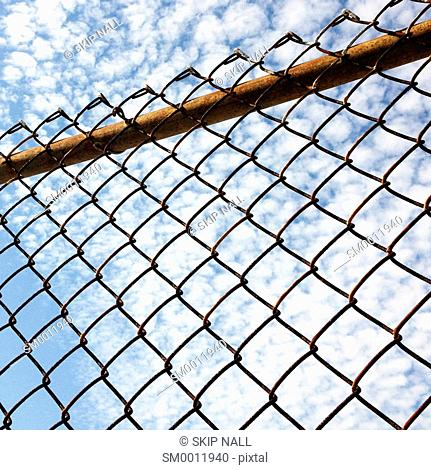 A chain link fence viewed from below