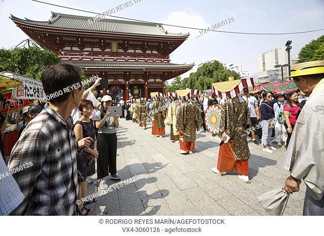 Participants dressing in traditional Japanese clothes walks towards Sensoji Temple during the Daigyoretsu or Large Parade of Sanja Matsuri Festival in Asakusa...