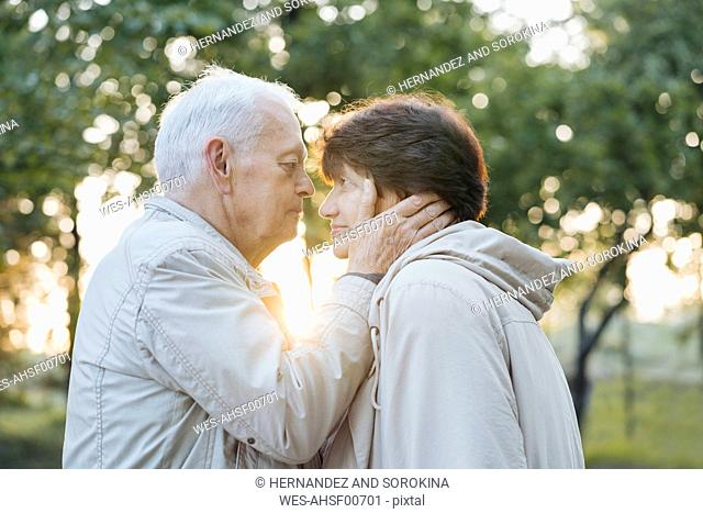 Profile of senior couple in love at sunset