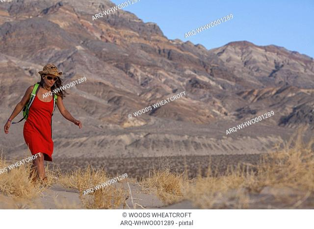 Woman Hiking In Death Valley National Park, California, Usa