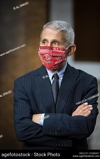 Anthony Fauci, director of the National Institute of Allergy and Infectious Diseases, wears a Washington Nationals face covering as he arrives during a Senate...