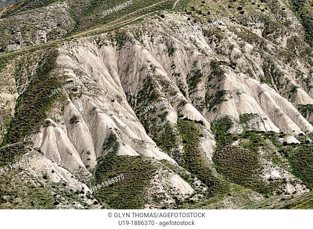 Calanchi del Cannizzola, a geological formation known as Badlands where softer sedimentary rocks and clay soils have been eroded by wind and water near...