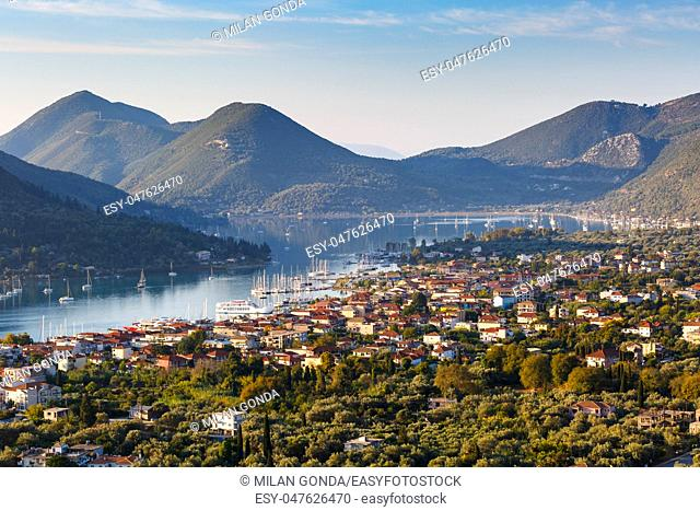 Morning view of Nydri village on Lefkada island with Ithaca and Kefalonia in the distance, Greece.