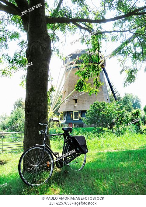 Bycicle next Windmill at Amstel river in Amsterdam,Netherlands
