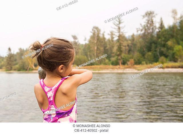 Girl in bathing suit at lake