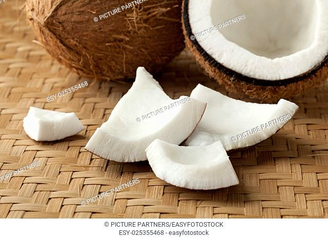 Cracked fresh coconut with pieces