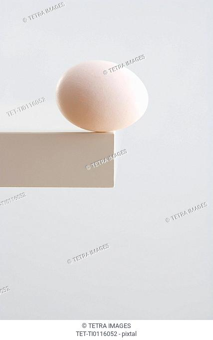 Egg on edge of table