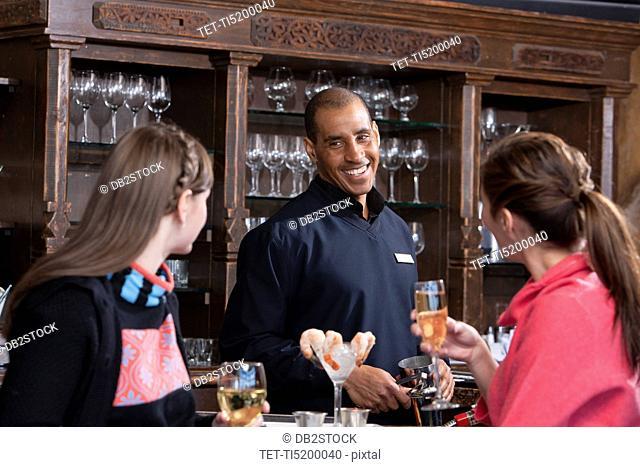 Young women enjoying apres ski drink in bar