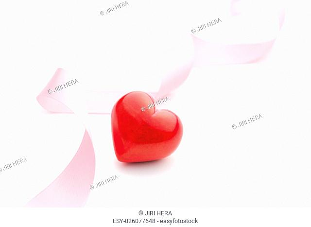 pink ribbon with red heart on white background