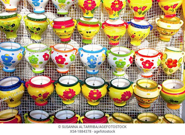 Vases of colorful ceramics to hang on the wall   A ceramic is an inorganic, nonmetallic solid prepared by the action of heat or cool  Ceramic materials may have...