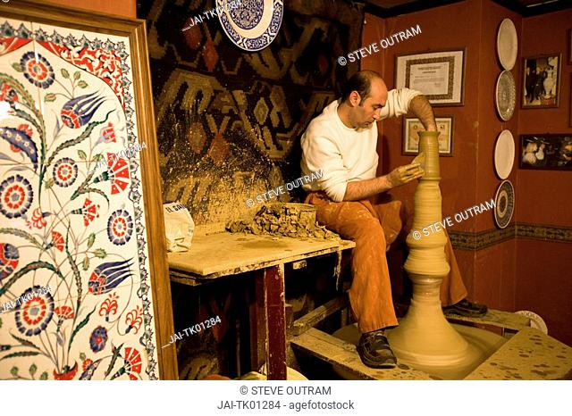 Master potter Ahmet at work at Firca Ceramics shop, Sultanahmet, Istanbul, Turkey MR and PR