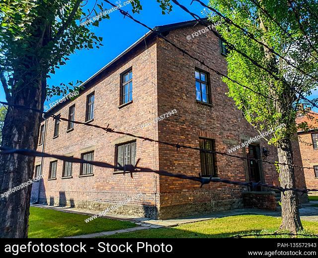 Auschwitz, Poland August 25, 2020: Auschwitz-Birkenau concentration camp - August 25, 2020 Barracks, exterior view, buildings, barbed wire,   usage worldwide