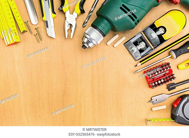 Working tools on wooden background with copy space