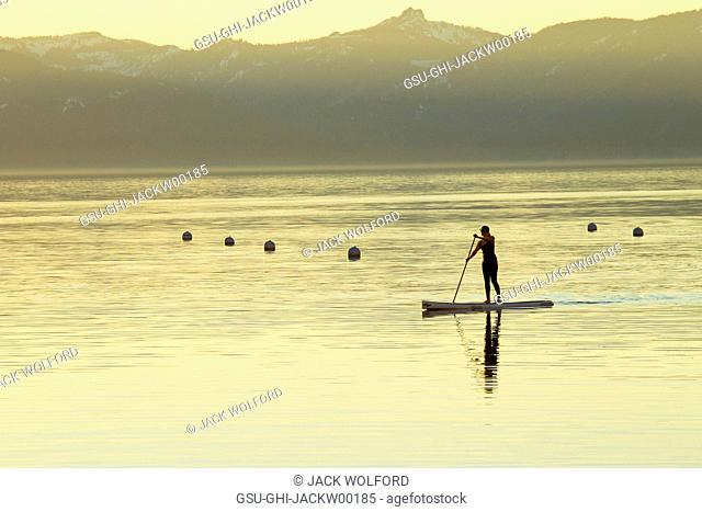 Woman on Paddle Board at Sunset, Lake Tahoe, Nevada, USA
