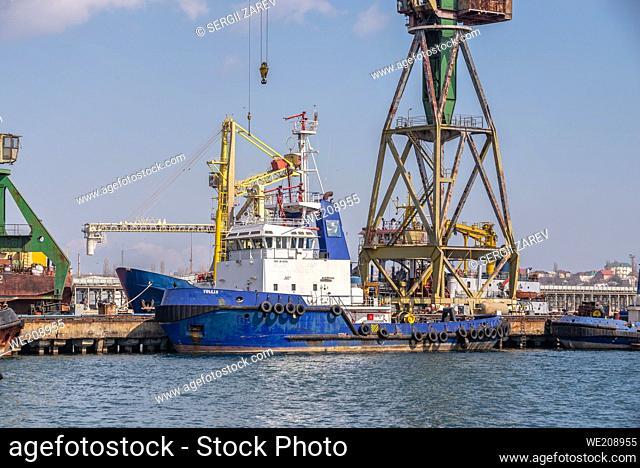 Chernomorsk, Ukraine. Tugboats in the Chernomorsk Shipyard on a sunny spring day
