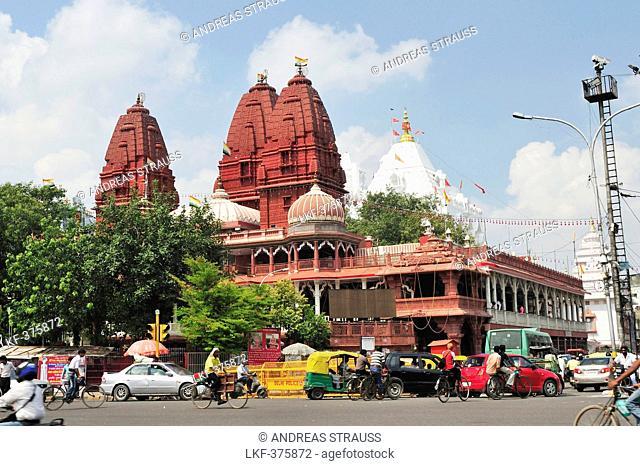 Street scene with red Jain temple in background, Old Delhi, Delhi, India